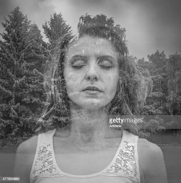 Double exposure portrait of beautiful girl