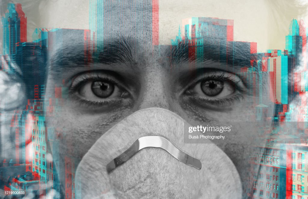Double exposure portrait of face of young man wearing face mask against virus epidemic and a New York City skyline : Stock Photo