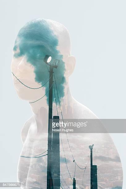 Double exposure portrait of man