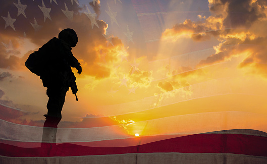Double exposure Silhouette of Soldier on the United States flag in sunset for Veterans Day is an official USA public holiday background,copy space. 1053001126