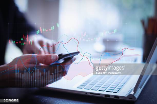double exposure trading growth graph on business and investment. digital technology background. - financial occupation stock pictures, royalty-free photos & images
