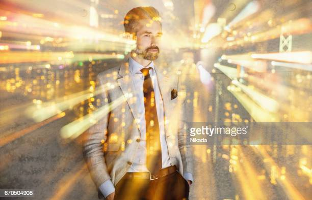 Double exposure with businessman man and city lights
