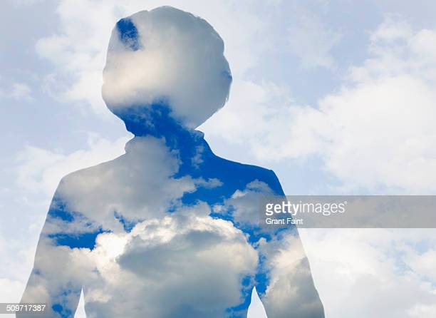 Double exposure:Older lady in clouds.