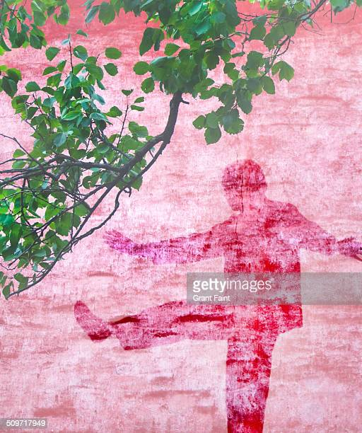 Double exposure:Tai chi shadow on red wall.