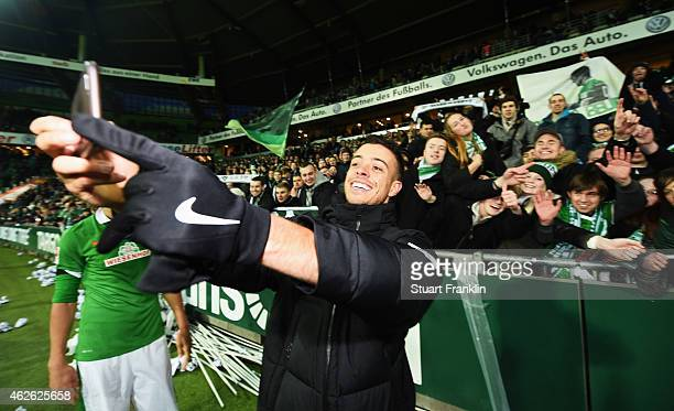 Double goal scorer Franco di Santo of Bremen makes a selfie with fans after the Bundesliga match between SV Werder Bremen and Hertha BSC at...