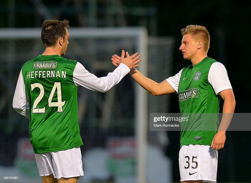 Double goal scorer Jason Cummings (R), is congratulated by team mate Paul Heffernan after the 2-0 victory over Hamilton Academical during the Scottish Premiership Play-off Final First Leg, between Hamilton Academical and Hibernian at New Douglas Park on May 21, 2014 in Hamilton Scotland.