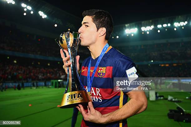 Double goal scorer Luis Suarez of Barcelona celebrates with the trophy following his team's 30 victory during the FIFA Club World Cup Final between...
