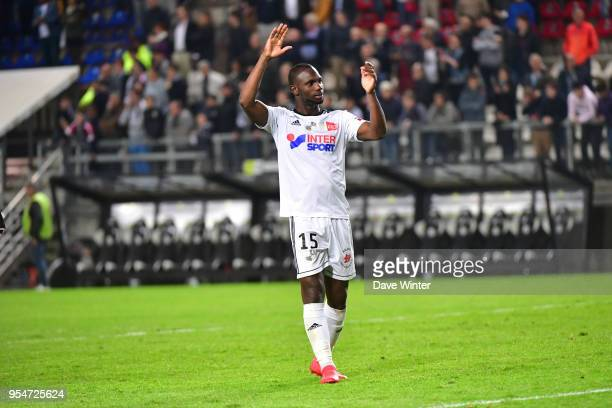Double goalscorer Moussa Konate of Amiens salutes the crowd at the end of the Ligue 1 match between Amiens SC and Paris Saint Germain at Stade de la...