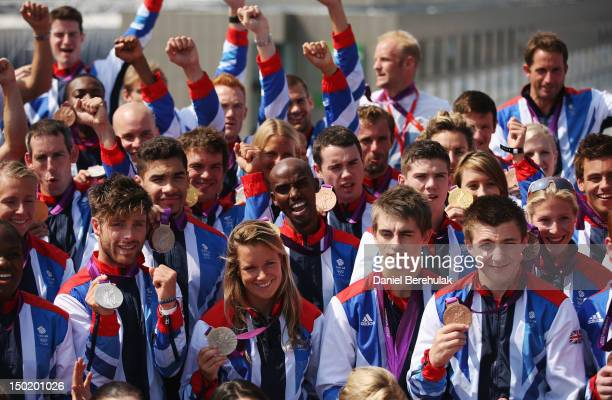 Double gold medalist Mo Farah of Great Britain poses with other medalists during a TEAM GB Press Conference during Day16 of the London 2012 Olympic...