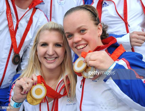 Double Gold medalists Rebecca Adlington and Eleanor Simmonds display their medals during Britain's Olympic medal winners parade on October 16 2008 in...