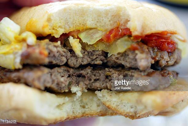A double hamburger is seen on July 18 2002 at a Burger King in Miami Florida The health effects of an American diet of supersized fast foods are...