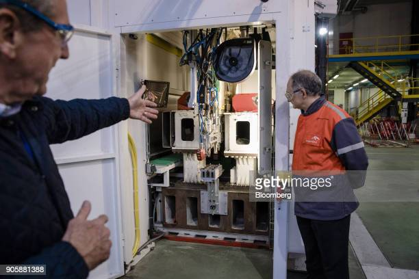 A double headed laser automobile part crafting machine stands on the production line at the ArcelorMittal research and development center in...