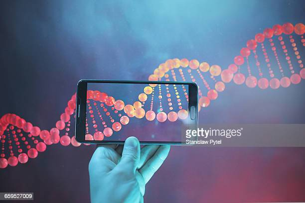 DNA double helix strand viewed with smartphone