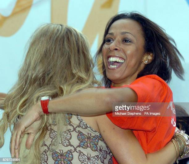 Double Olympic champion Dame Kelly Holmes celebrates with television presenter Katy Hill after it was announced that London won the bidding