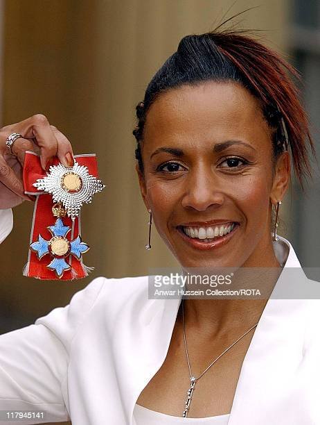 Double Olympic gold medallist Dame Kelly Holmes at Buckingham Palace London after receiving her Dame Commander of the Order of the British Empire...