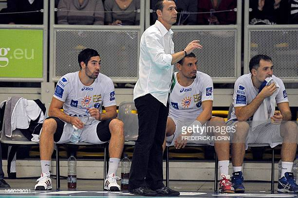 Double Olympic handball champion Nikola Karabatic sits on the bench next to Montpellier's coach Patrice Canayer during his first match with the...