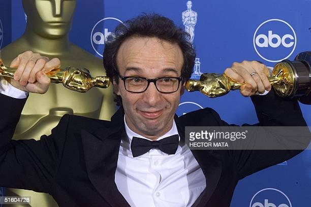 Double Oscar winner for Best Foreign Film and Best Actor Roberto Benigni poses for photographers 21 March 1999 at the Dorothy Chandler Pavilion in...