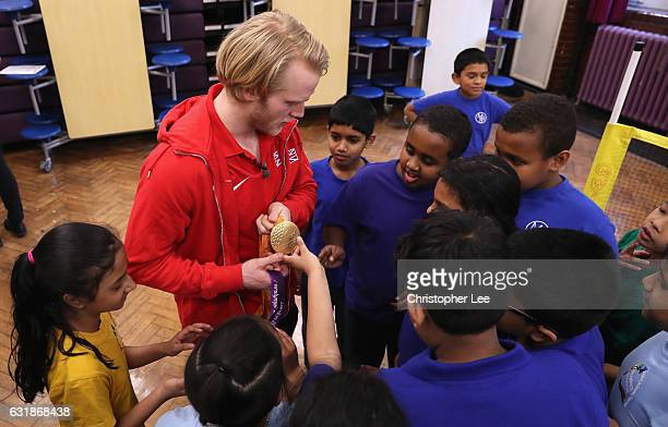 Double Paralympic champion Jonnie Peacock shows kids from Marion Richardson School his gold medals on January 17 2017 in London England during the...