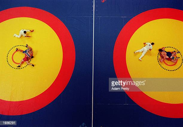 A double pin takes place on two wrestling mats simutaneously during the Wrestling Junior World Championships on August 20 1999 at the State Sports...
