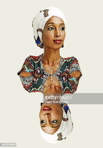 double portrait of an ethiopian lady in studio - symmetry stock photos and pictures