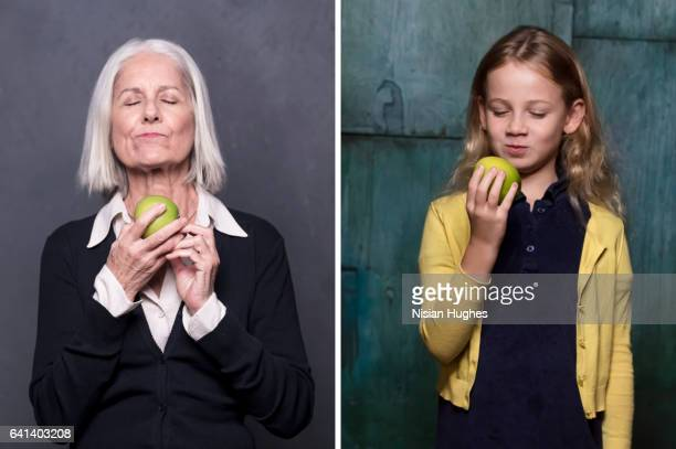 Double portrait of older woman and young girl eating apples