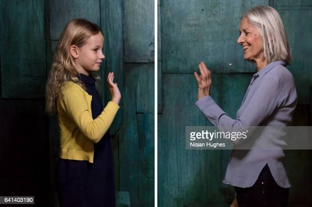 double portrait of older woman and young girl waving to each other - generation gap stock pictures, royalty-free photos & images