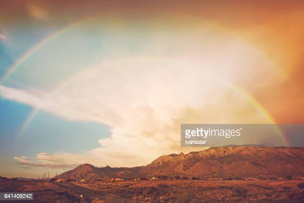 Double rainbow after a storm, with Sandia mountains in background