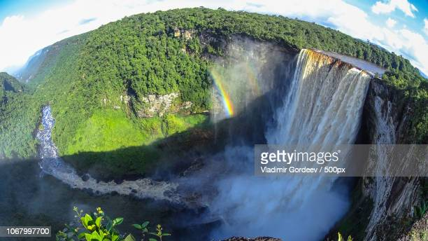 double rainbow against tall scenic waterfall - guyana stock pictures, royalty-free photos & images