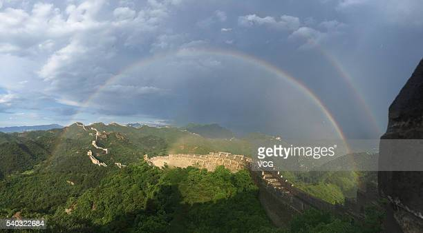 Double Rainbow appear above Jinshanling section of the Great Wall after the thunderstorm at Luanping County on June 15 2016 in Chengde Hebei Province...
