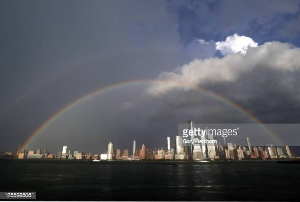 Double rainbow appears in the sky over the skyline of lower Manhattan and One World Trade Center in New York City following a thunderstorm before...