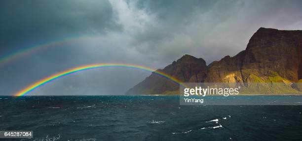 double rainbow at na pali coast in kauai, hawaii - doubles stock photos and pictures