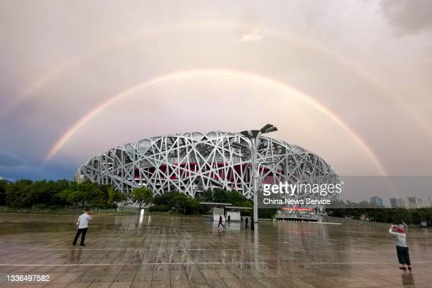 Double rainbow hangs in the sky over the Bird's Nest on August 26, 2021 in Beijing, China.