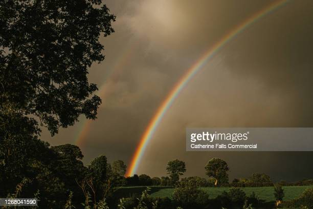 double rainbow in a pregnant sky - symbolism stock pictures, royalty-free photos & images