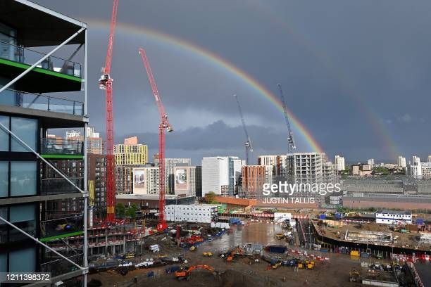 Double rainbow is pictured over the construction site for new build new residential apartments and a retail complex, at Nine Elms in south London on...