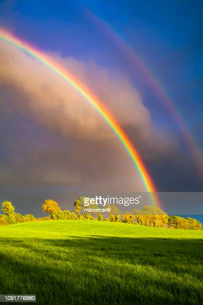 double rainbow landscape in beautiful irish landscape scenery. co tipperary ireland. - rainbow stock pictures, royalty-free photos & images
