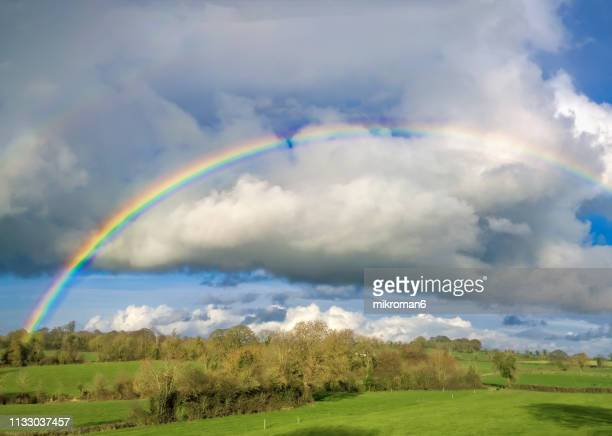 double rainbow landscape in beautiful irish landscape scenery. - weather stock pictures, royalty-free photos & images