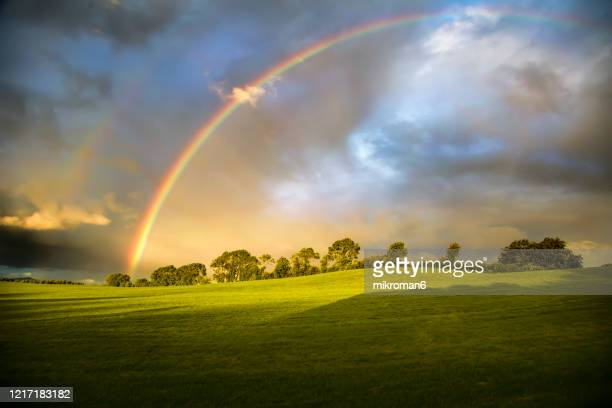 double rainbow landscape - weather stock pictures, royalty-free photos & images