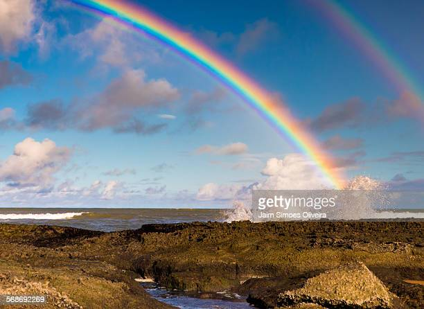 A double rainbow over a breaking wave at the reefs