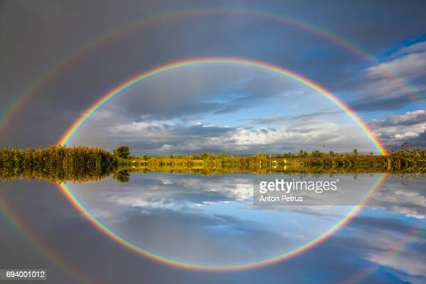 double rainbow over the river - anton petrus panorama of beautiful sunrise stock pictures, royalty-free photos & images
