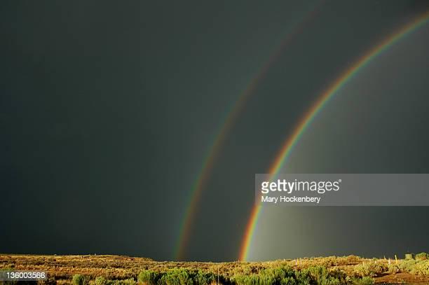 double rainbow with dark sky - mary moody fotografías e imágenes de stock