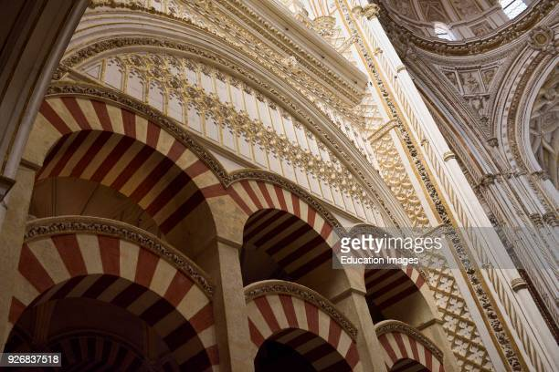 Double red and white arches of the Prayer Hall looking up to the main altar dome in the Cordoba Cathedral Mosque