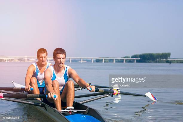 Double scull rowing on the river