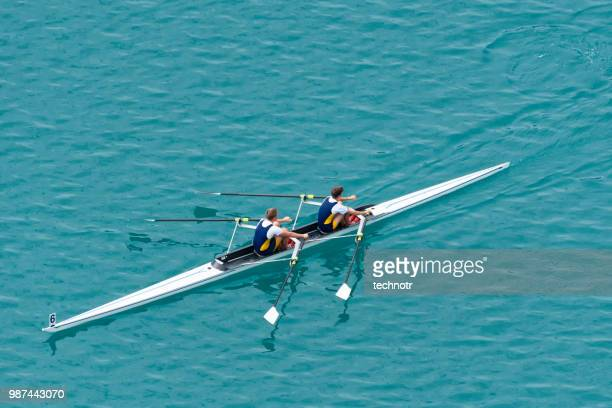 double scull rowing team practicing - rowing boat stock pictures, royalty-free photos & images