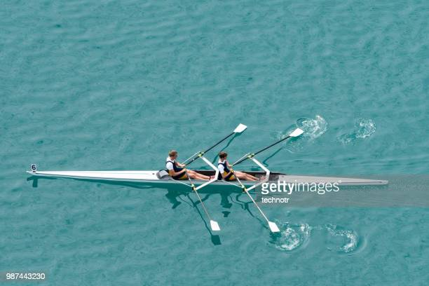 double scull rowing team practicing - rowing stock pictures, royalty-free photos & images