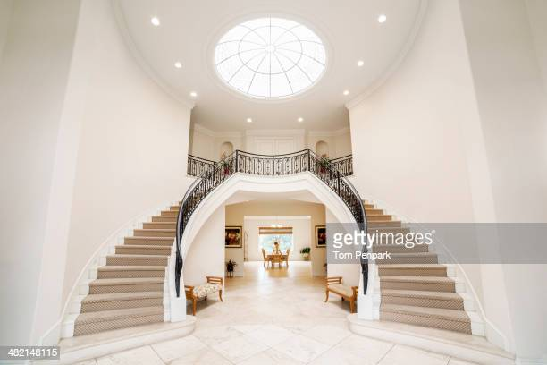 double staircase in ornate home - majestic stock pictures, royalty-free photos & images