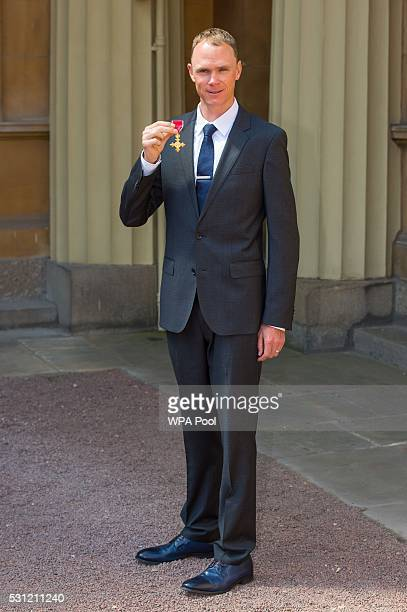Double Tour de France winning cyclist Chris Froome poses after he received an OBE from the Duke of Cambridge at an investiture ceremony at Buckingham...