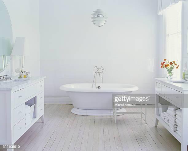 Double Vanities in White Bathroom with Bleached Wood Floor