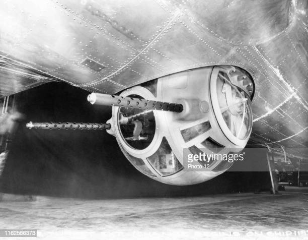 """Double ventral machine gun station under the fuselage of an American strategic heavy bomber Boeing B-29 """"Superfortress"""". 1944."""