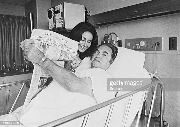Double Victory Follows Near Tragedy Silver Spring MD Alabama Governor George C Wallace and his wife Cornelia hold up newspaper May 17th headline...