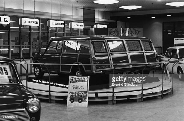 A double width Mini Minor in a car showroom with the numberplate 'Breadthalyser' May 1968